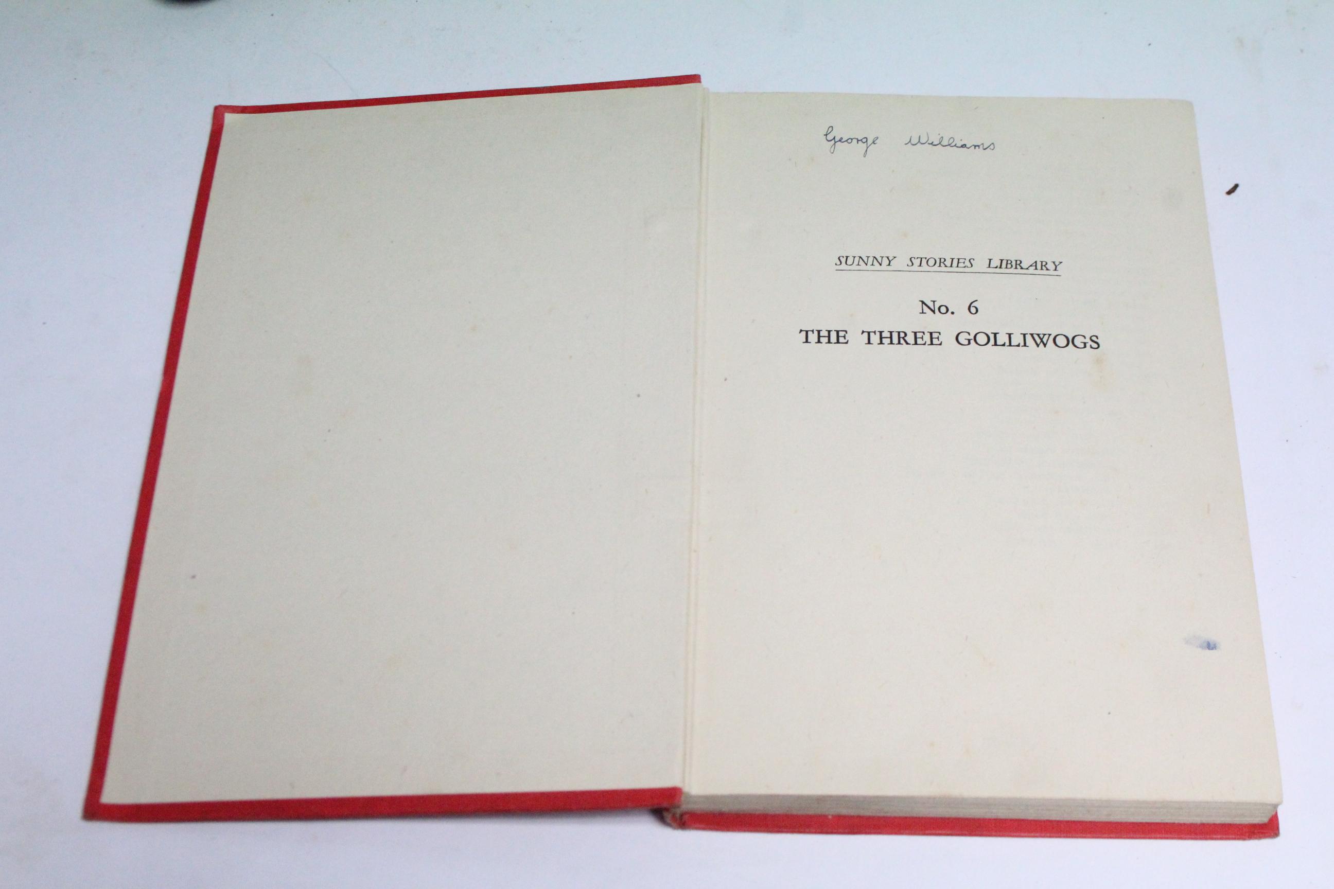 """Lot 106 - One volume """"The Three Golliwogs"""" by Enid Blyton"""" (1944); & three Golliwog soft toys."""