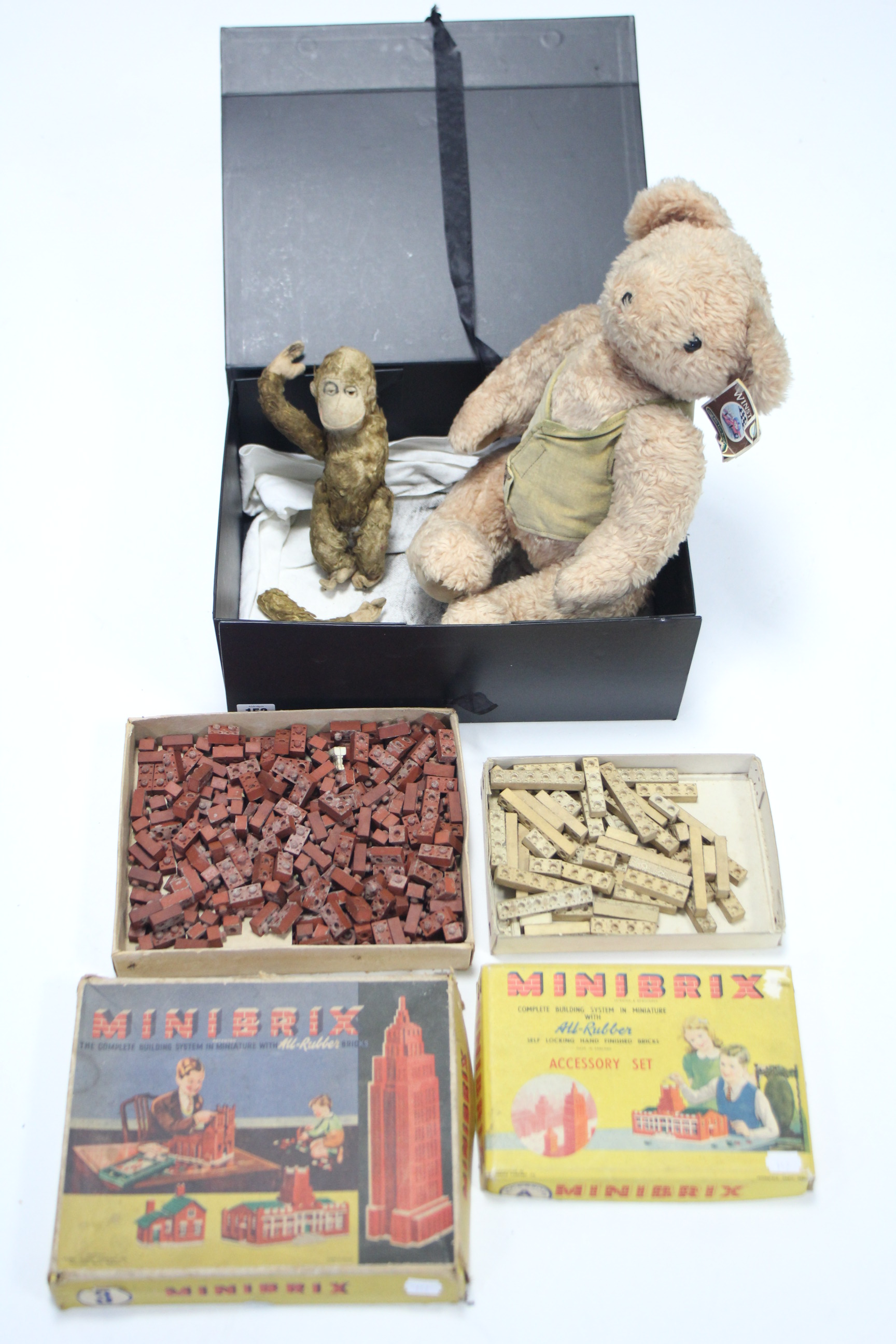 "Lot 297 - A Minibrix ""3"" building system; a ditto ""A"" accessory kit, both boxed; a golden plush monkey soft"