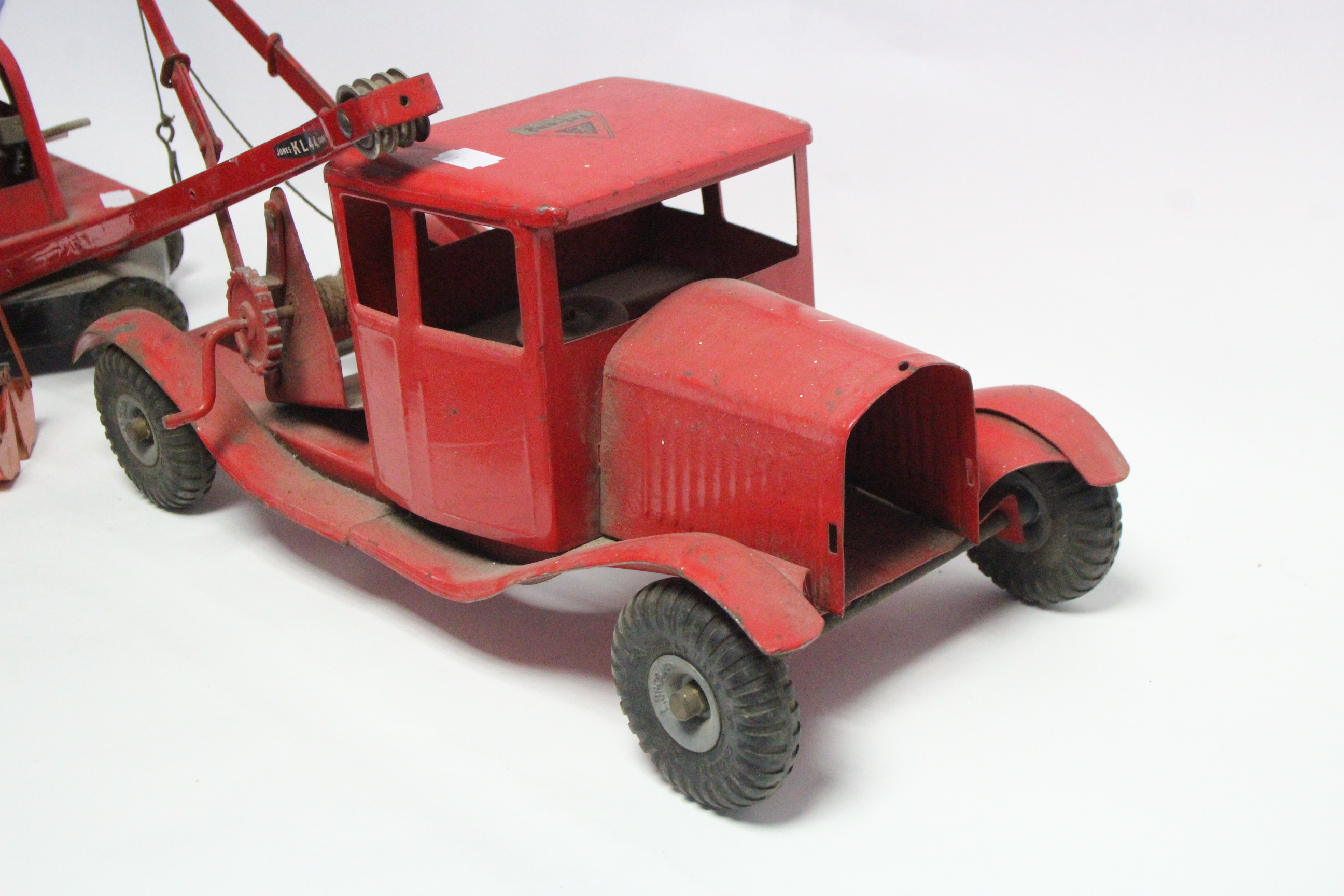Lot 292 - A Tri-ang tinplate toy pickup truck; & a ditto toy crane.