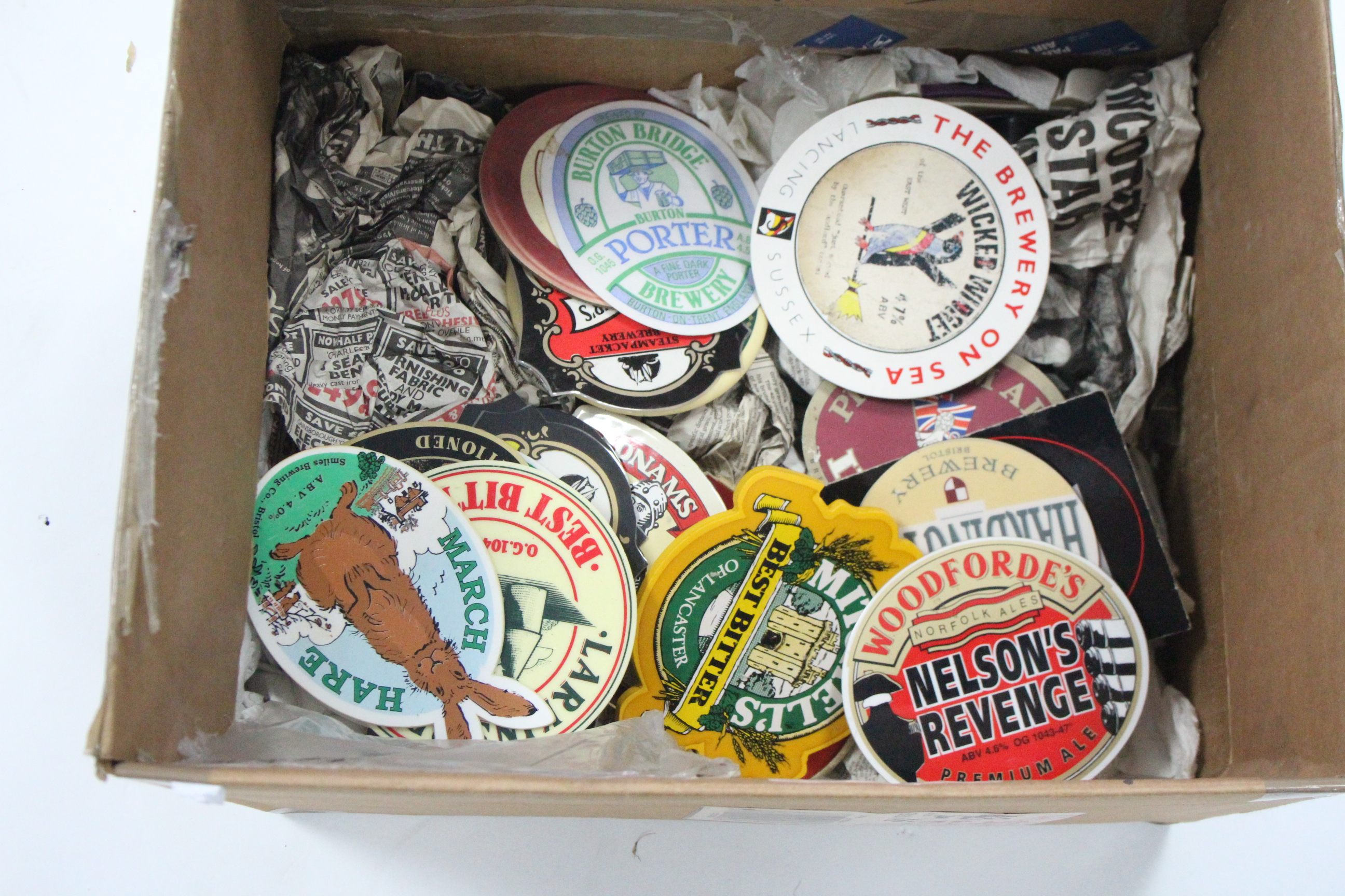 Lot 63 - A collection of sixteen beer pump name plates mounted on wooden board; together with various other