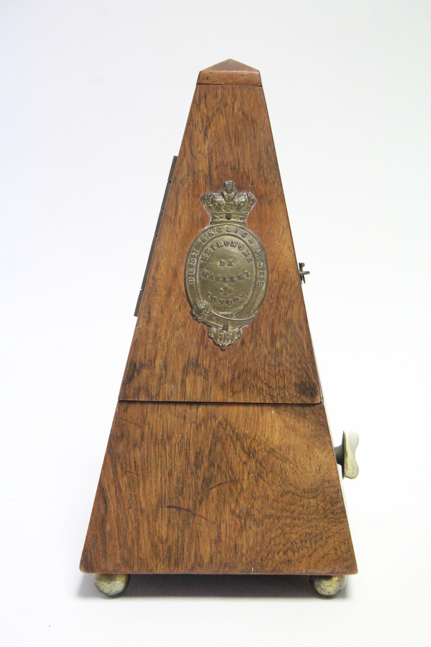 "Lot 51 - A Maelzel of London metronome in walnut case, 9½"" high, w.a.f."