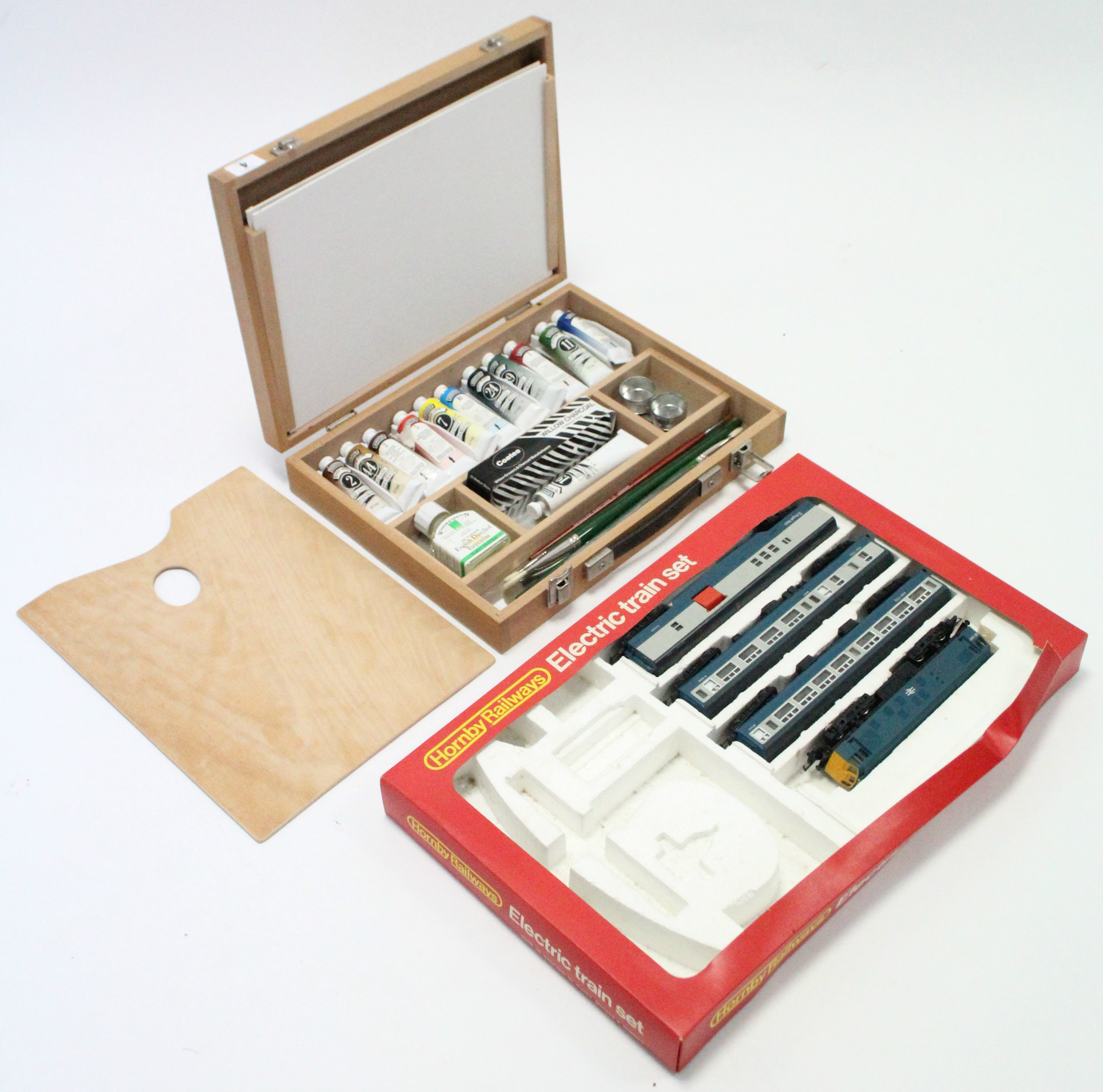 A Winsor & Newton artist's paint box with contents; & a Hornby Railways part electric train set,