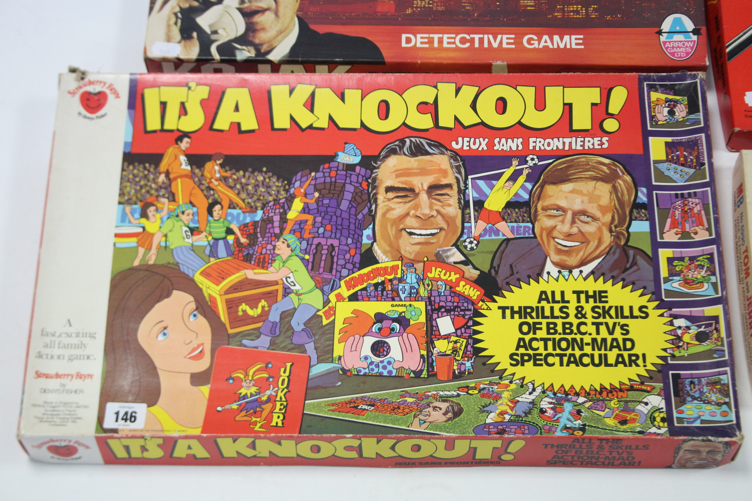 "Lot 296 - A Strawberry Fayre Denys Fisher ""It's A Knockout"" board game; an Arrow ""Kojak"" board game; a"