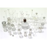 Approximately thirty various clear glass laboratory receptacles.