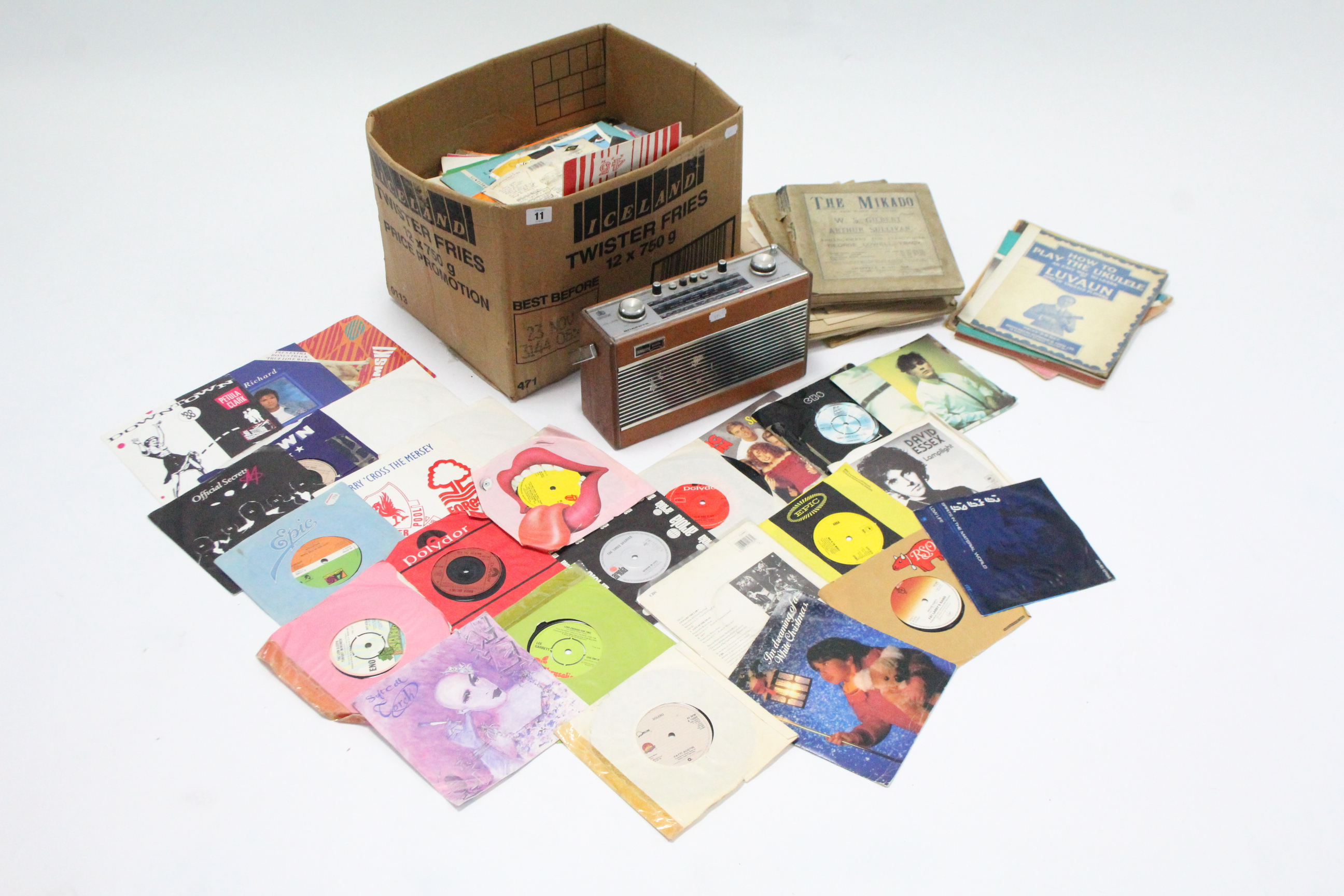 "Lot 11 - A Roberts ""R606-MB"" portable radio; & a quantity of sheet music."