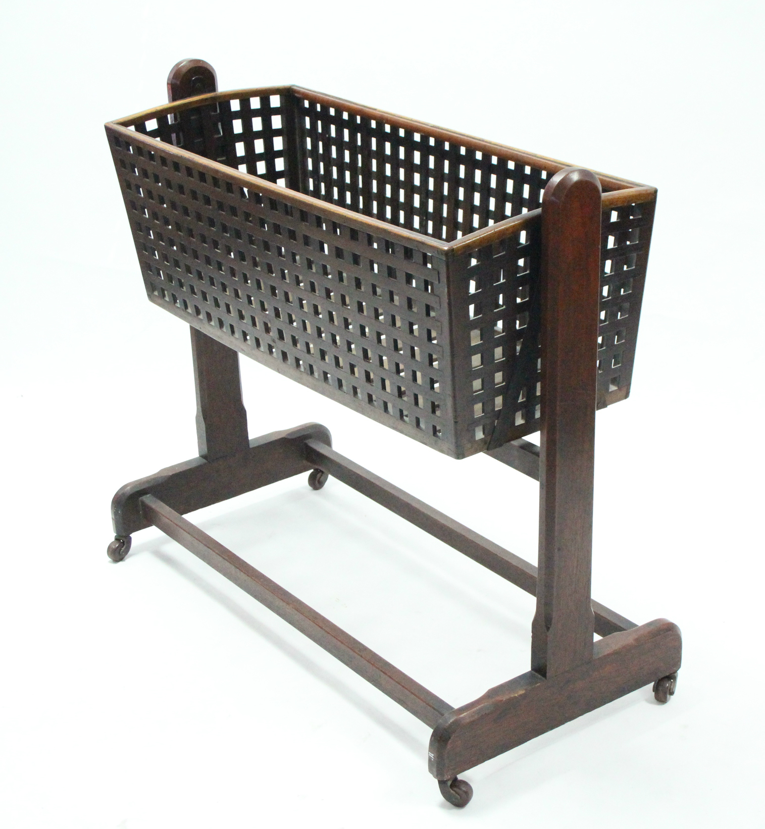 Lot 44A - A Victorian pierced walnut cradle with plain upright supports & stretchers, on ceramic castors;