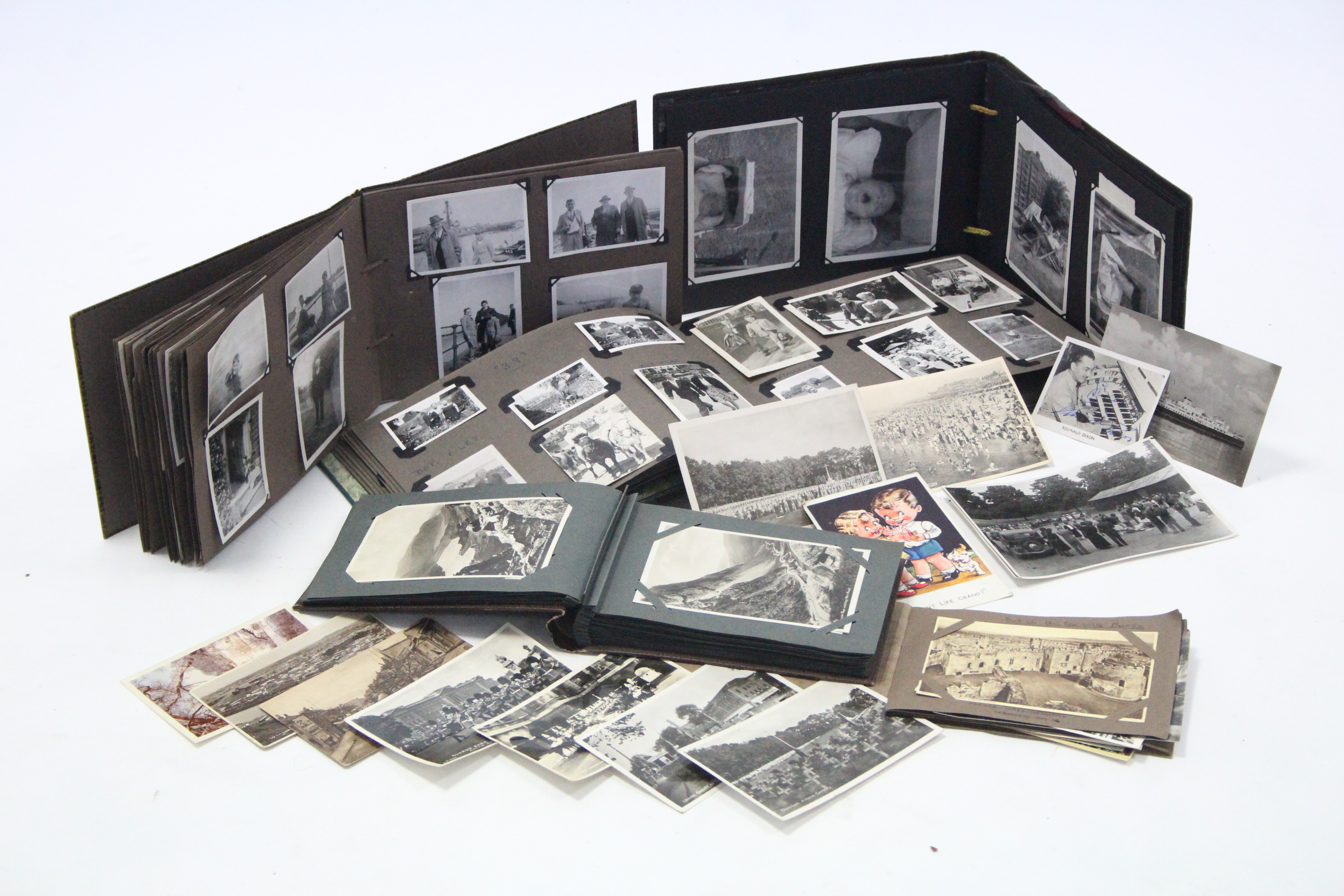 Lot 113 - Various assorted postcards & family photographs, early-mid 20th century, contained in five