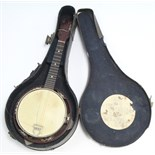 "A banjo, 21¾"" long, in black fibre-covered case."