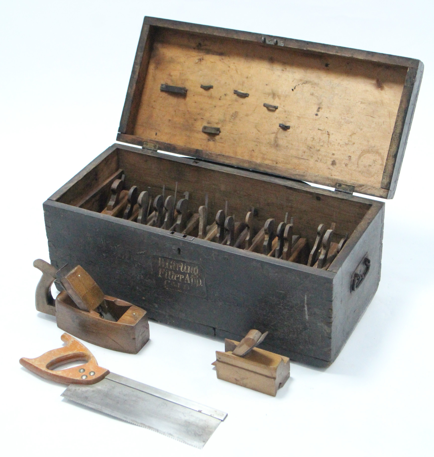 """Lot 34 - A black painted deal tool chest, 25½"""" wide, containing various carpenter's tools."""
