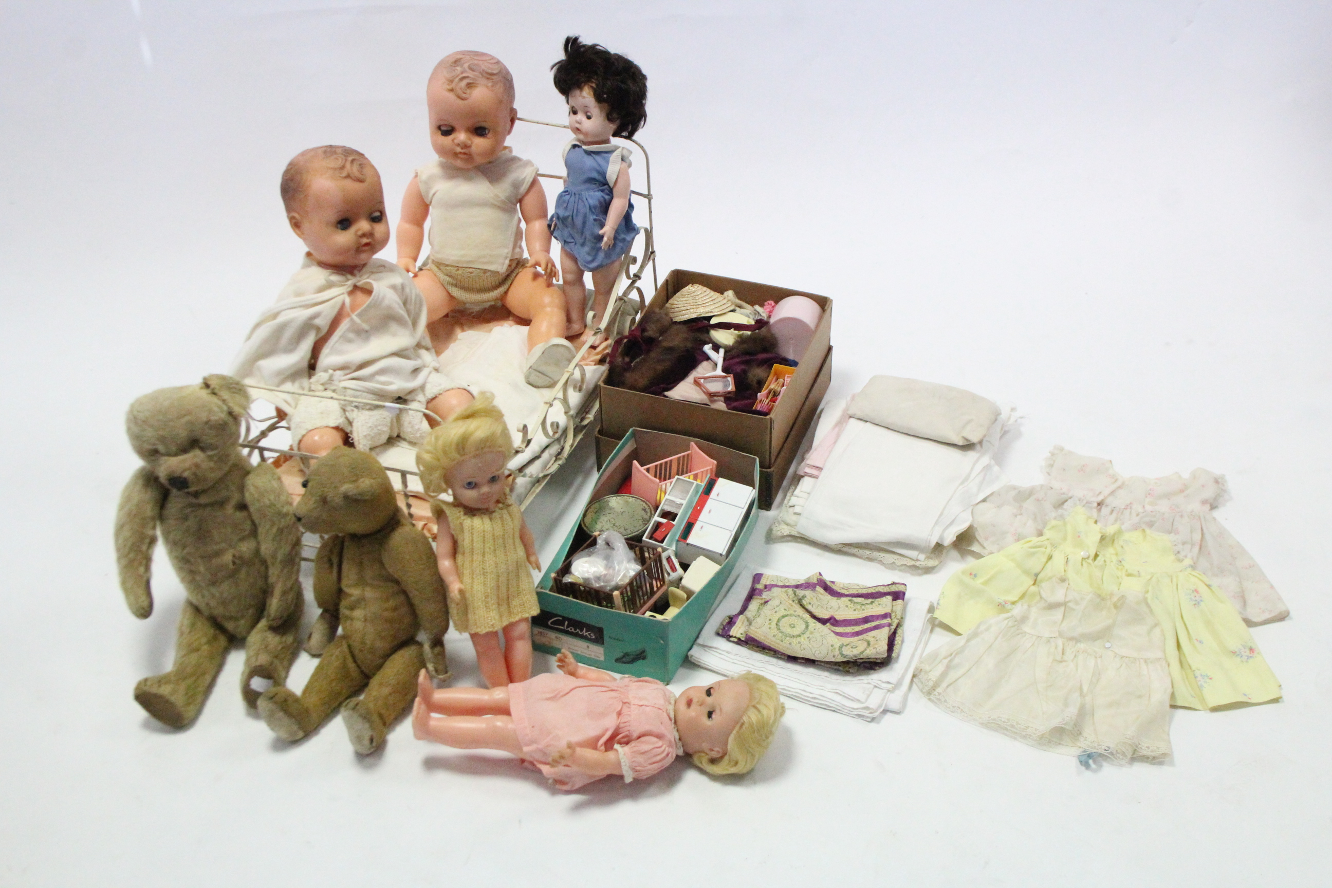 Lot 321 - Two teddy bears (worn); five celluloid dolls; a white painted wrought-iron doll's cot; & various