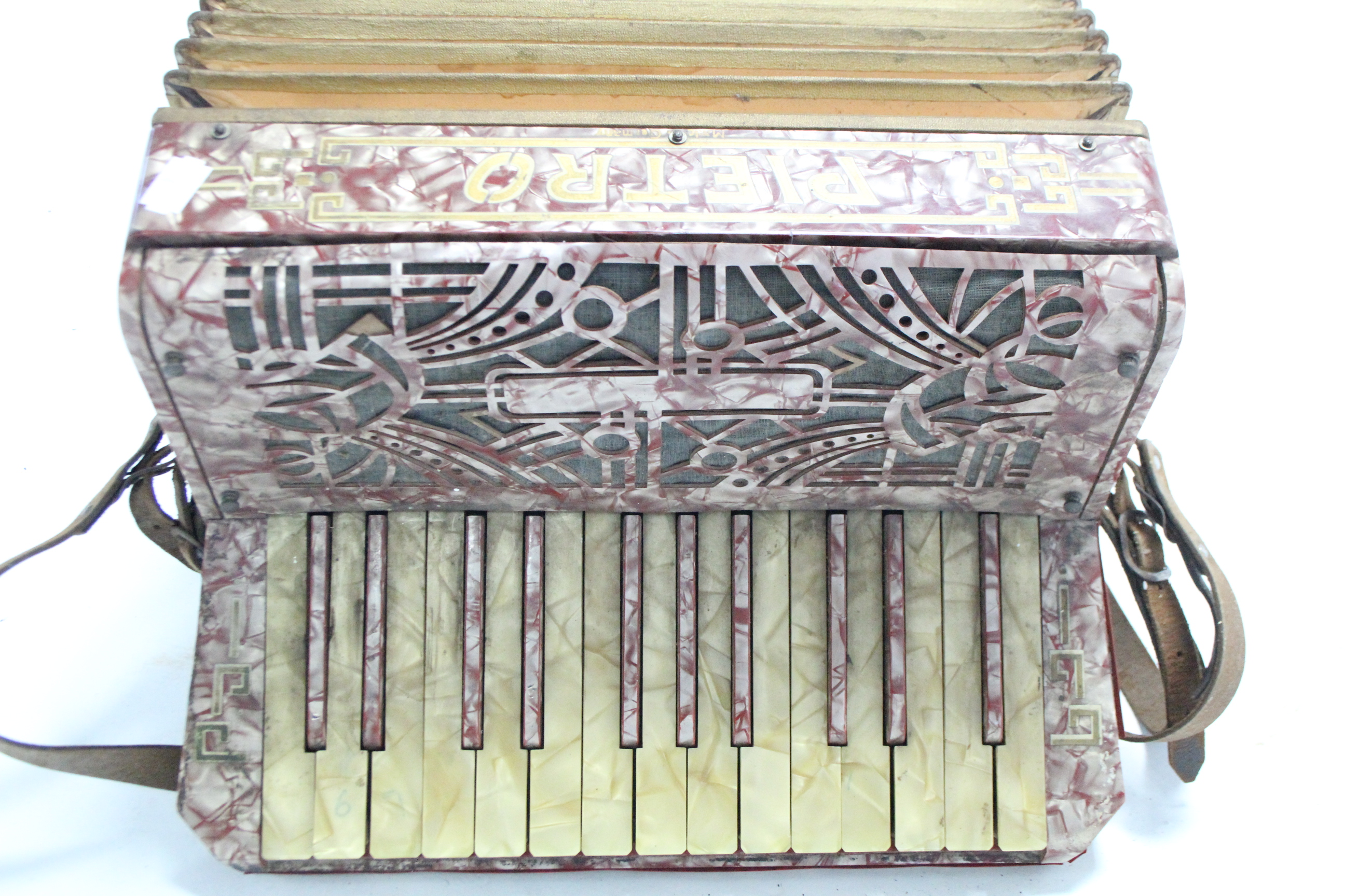 Lot 48 - A Pietro piano accordion in crimson & silver polished case, lacking travelling case.