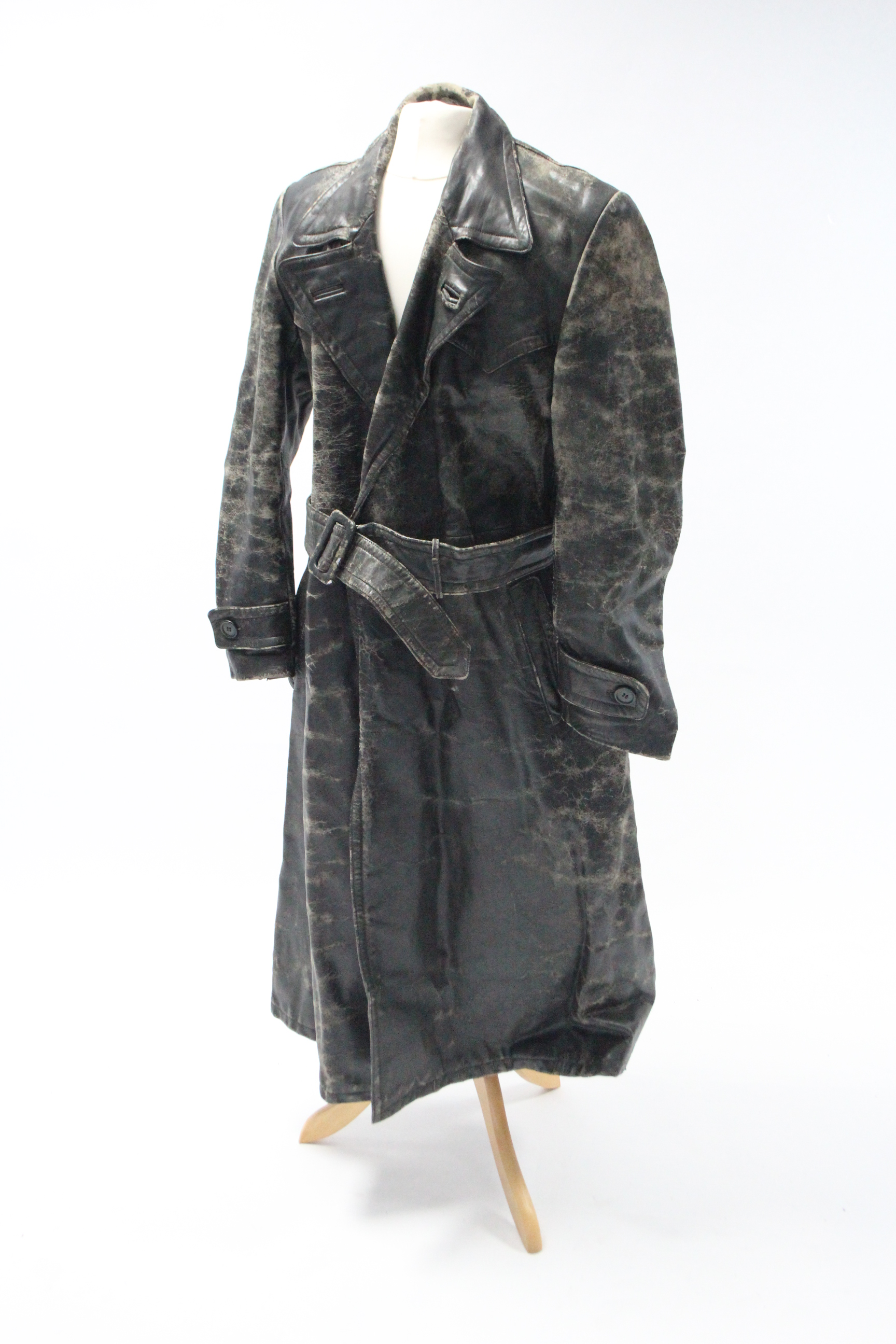 Lot 23 - A mid-20th century black-finish horse-hide German policeman's three-quarter length coat.