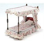 A doll's four-poster bed, complete with bedding & drapes; together with a two-tier ash wall