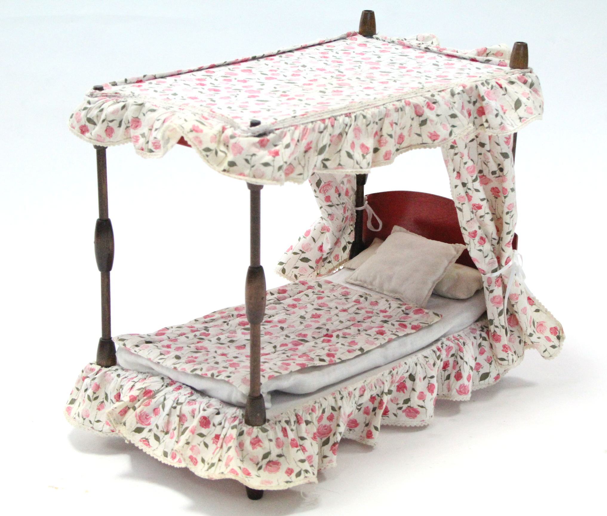Lot 329 - A doll's four-poster bed, complete with bedding & drapes; together with a two-tier ash wall