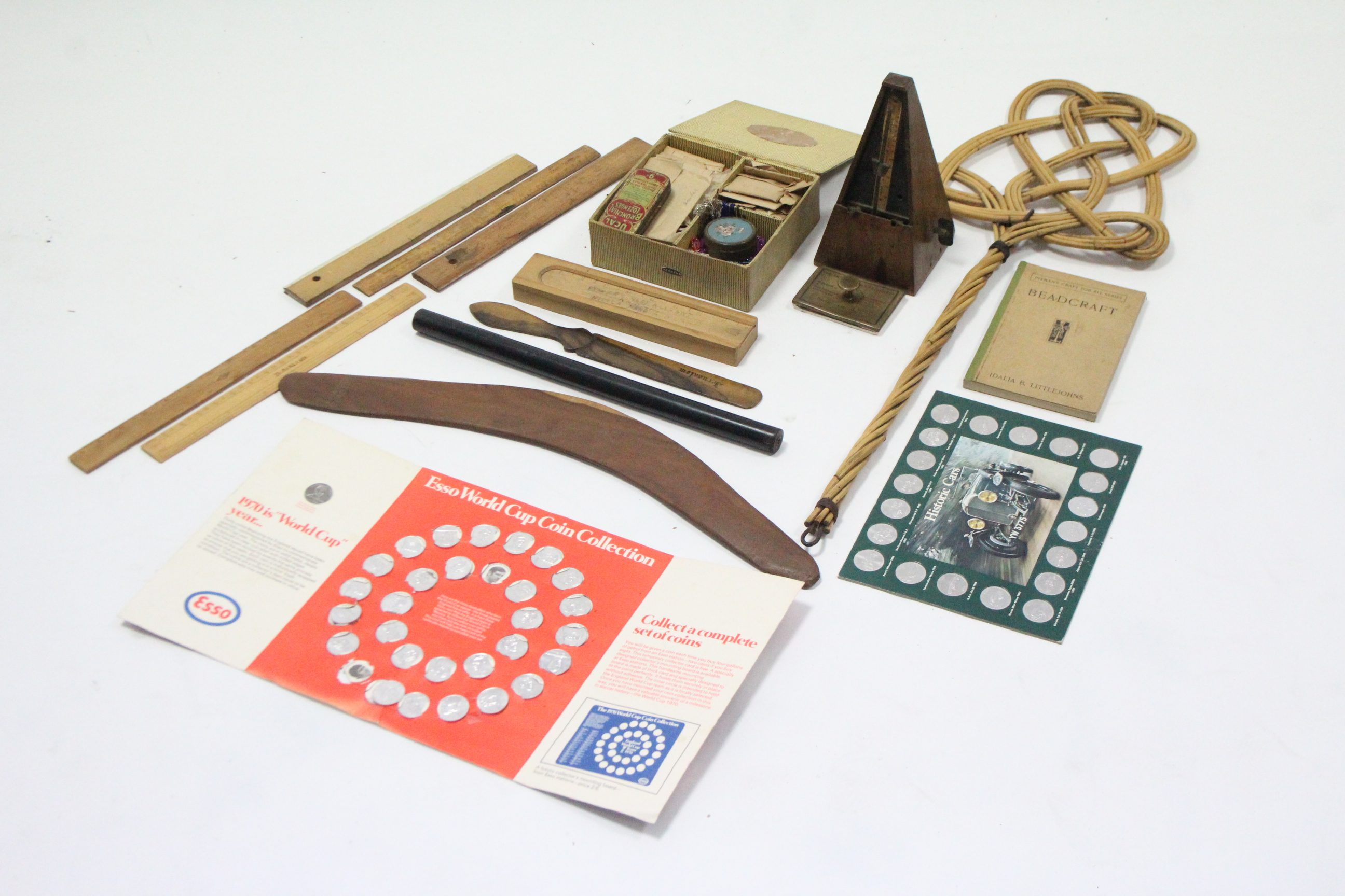 Lot 31 - A metronome (lacking front cover); a Beadcraft set; a cane carpet beater; a boomerang; & sundry