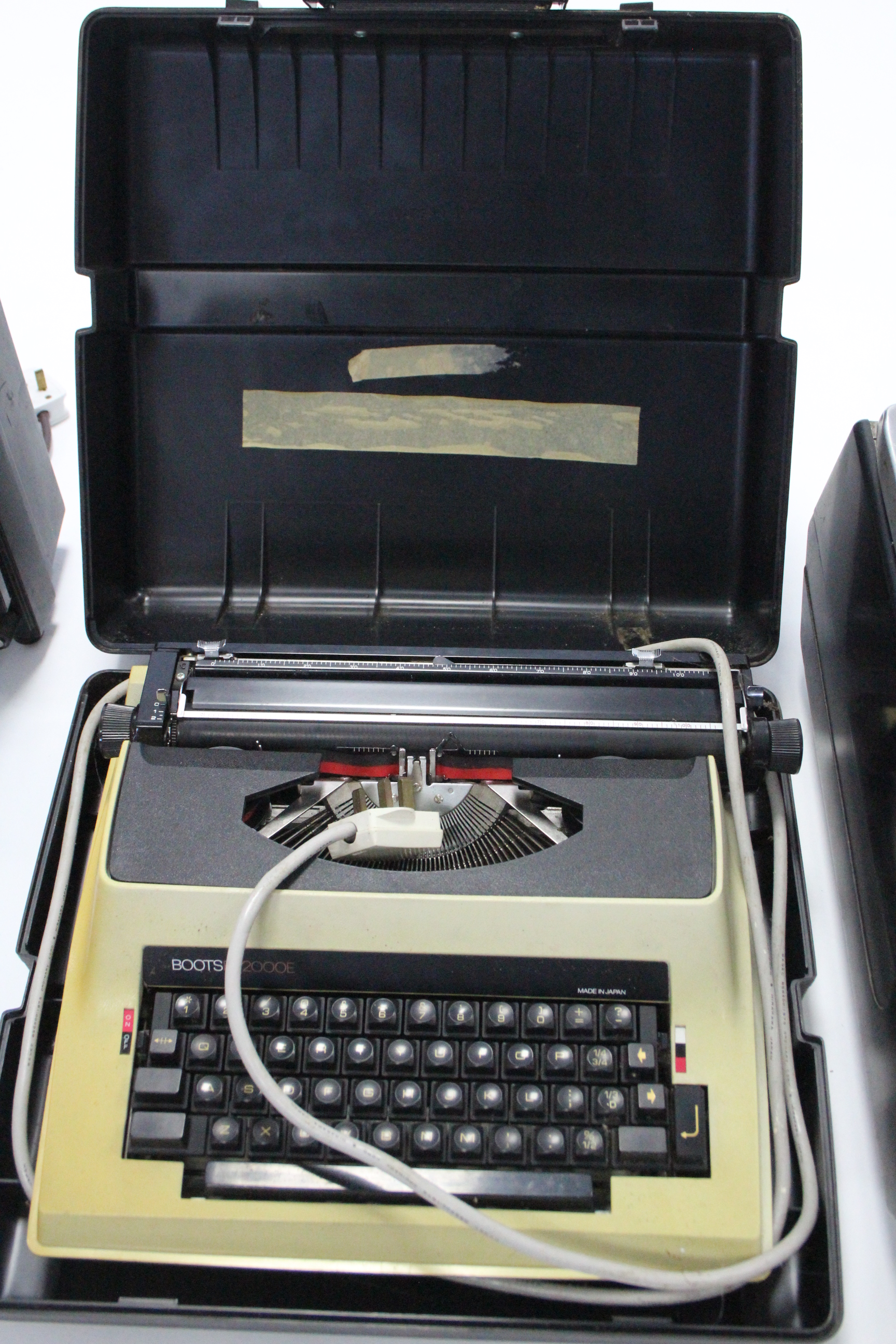 Lot 25 - A Berkel vintage scale (Type 567); a Boots electric typewriter with case; & two film projectors.