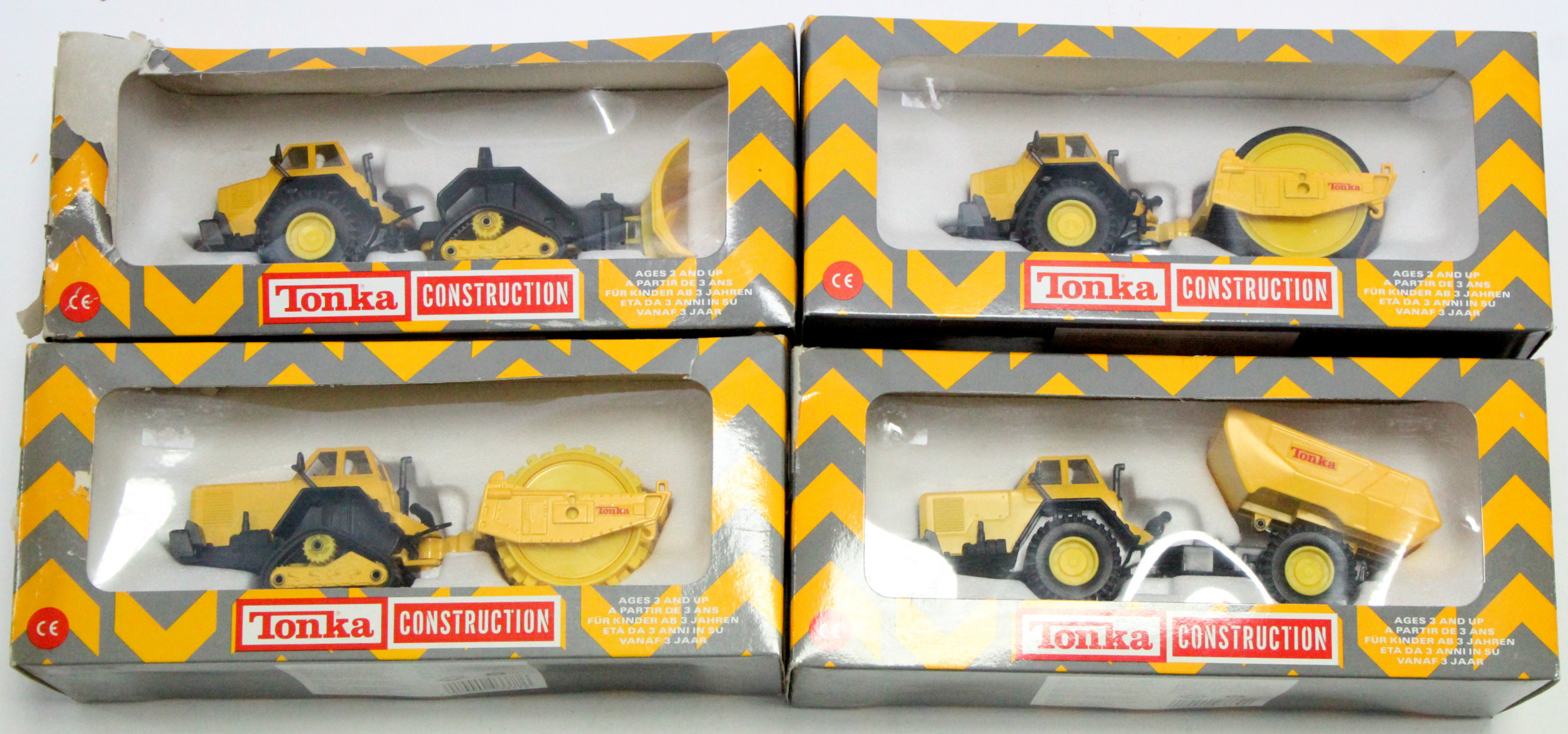 Lot 261 - Four Tonka Toy construction vehicle models, each with window box.