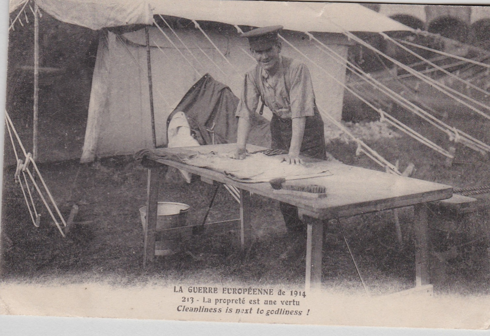"""Lot 123 - La Guerre European de 1914 WWI Postcard """"Cleanliness is next to Godliness!"""", shows a soldier washing"""