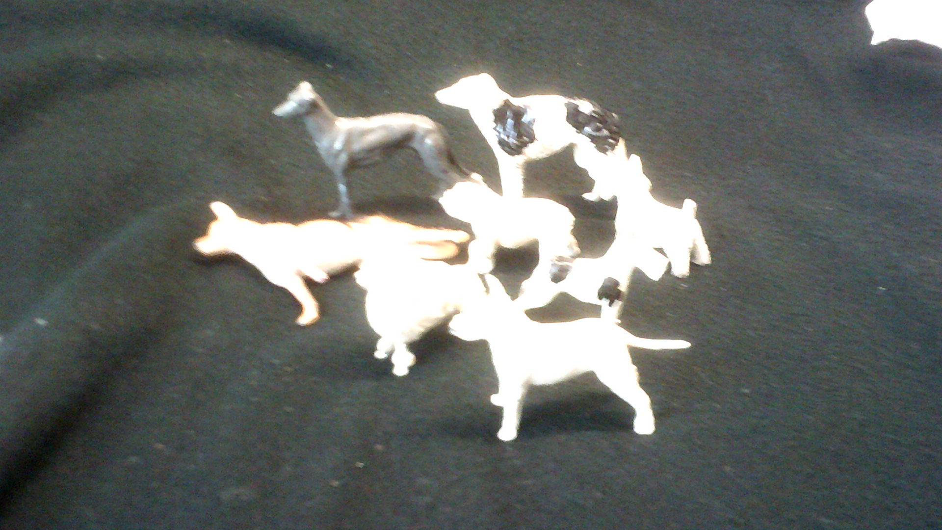 Lot 395 - Toy Figures - eight large lead animal dog figures made in England C1950's plated with condition
