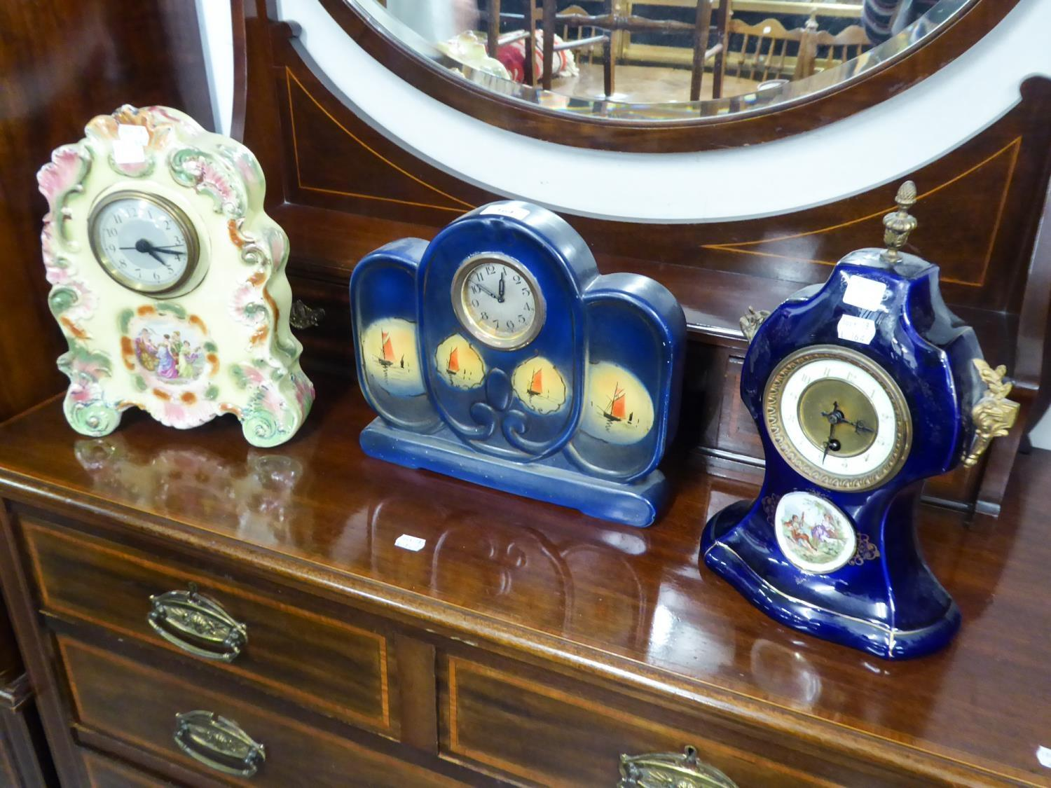 Lot 164 - EARLY 20TH CENTURY MANTEL CLOCK IN BLUE GLAZED POTTERY CASE OF WAISTED FORM WITH GILT METAL