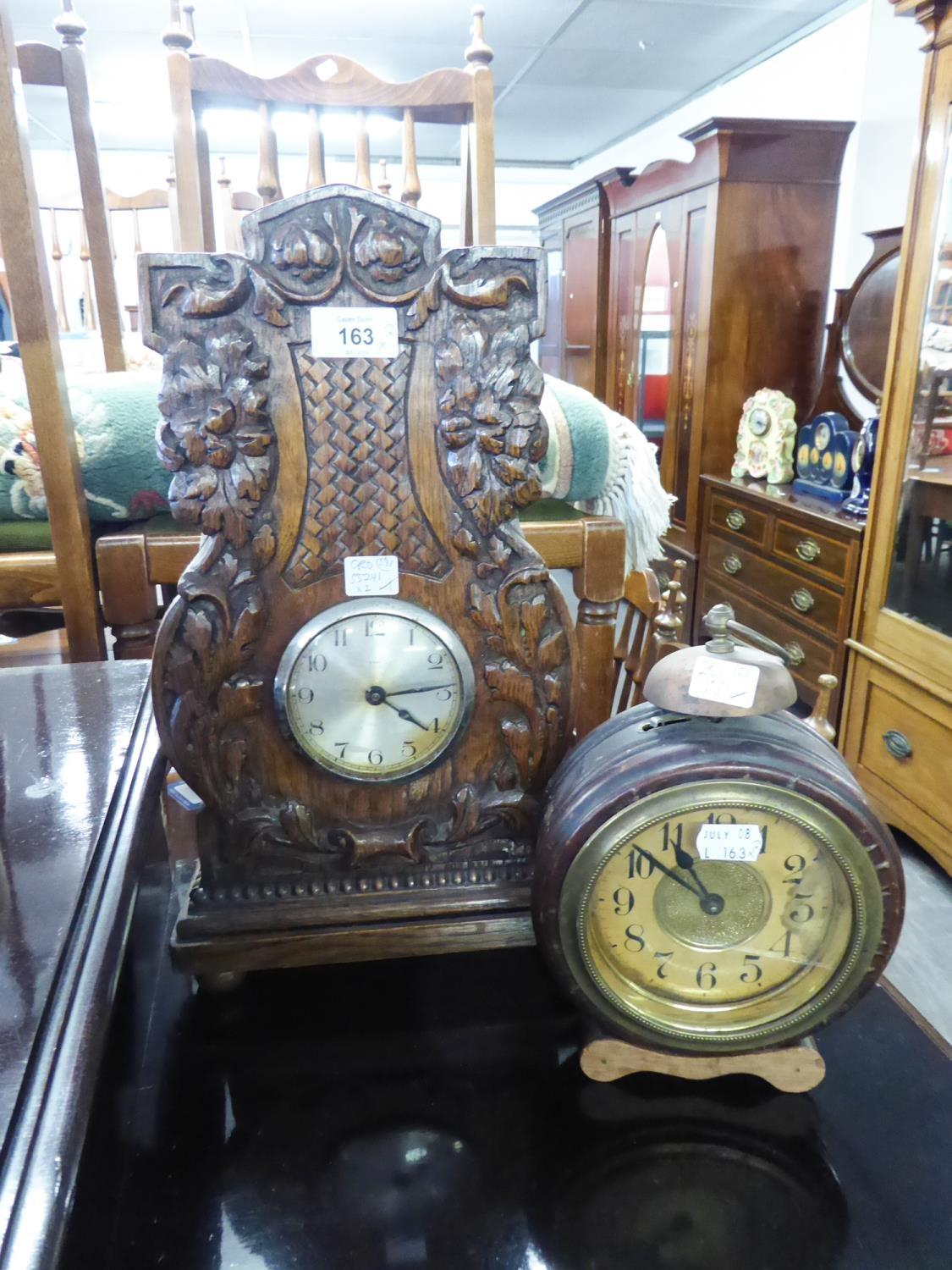 CIRCA 1920's TALL MANTEL CLOCK WITH PLATED DRUM SHAPED 8 DAY MOVEMENT IN OAK CASE WITH FOLIATE AND