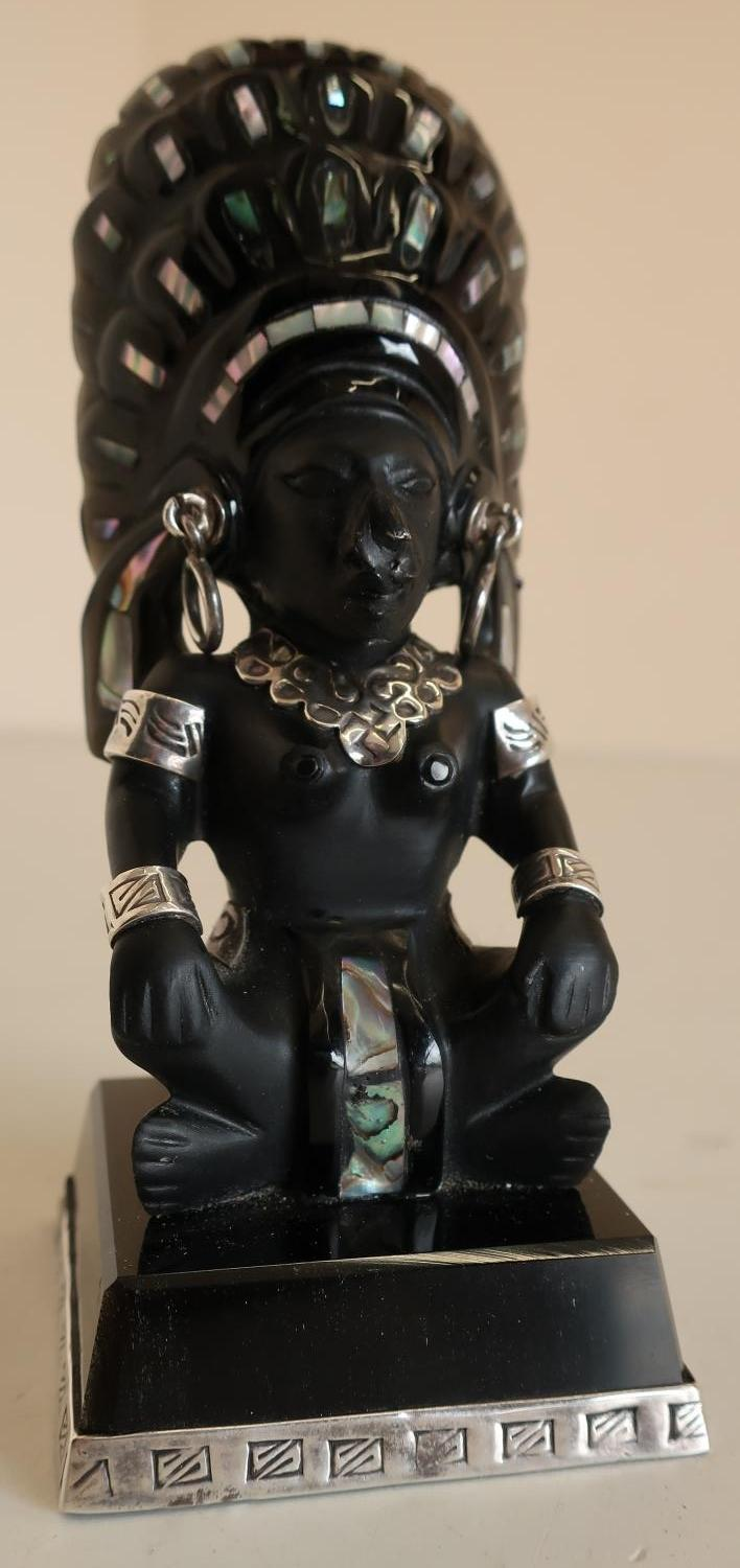 Lot 147 - Carved obsidian Mexican Taxco Aztec figurine inlaid with silver and Mother of Pearl (height 12cm)