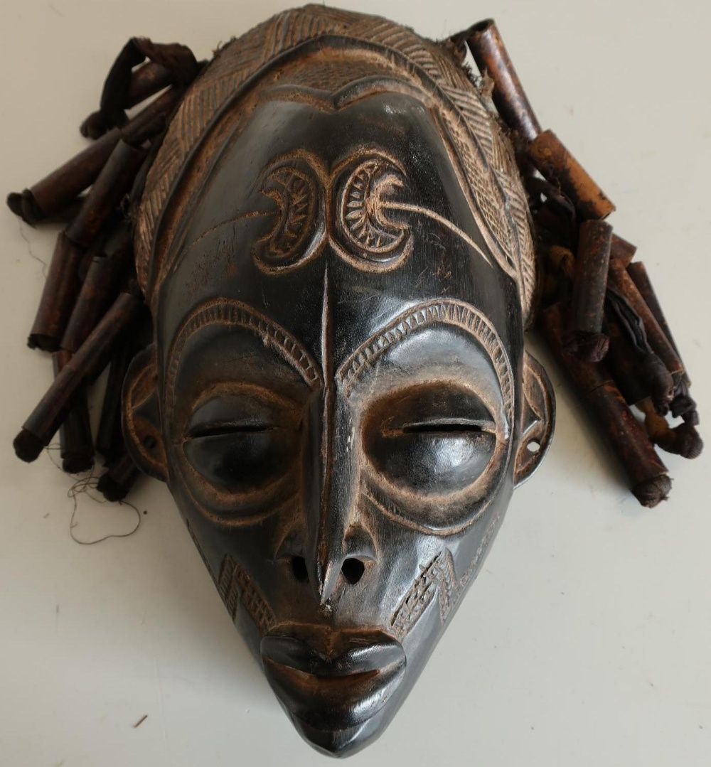 Lot 139 - Carved African style tribal face mask with ribbon and beadwork hair