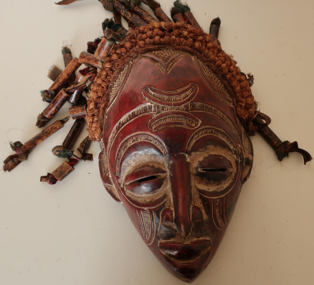 Lot 144 - Large carved African style carved tribal face mask with highlighted detail, hessian ropework, ribbon