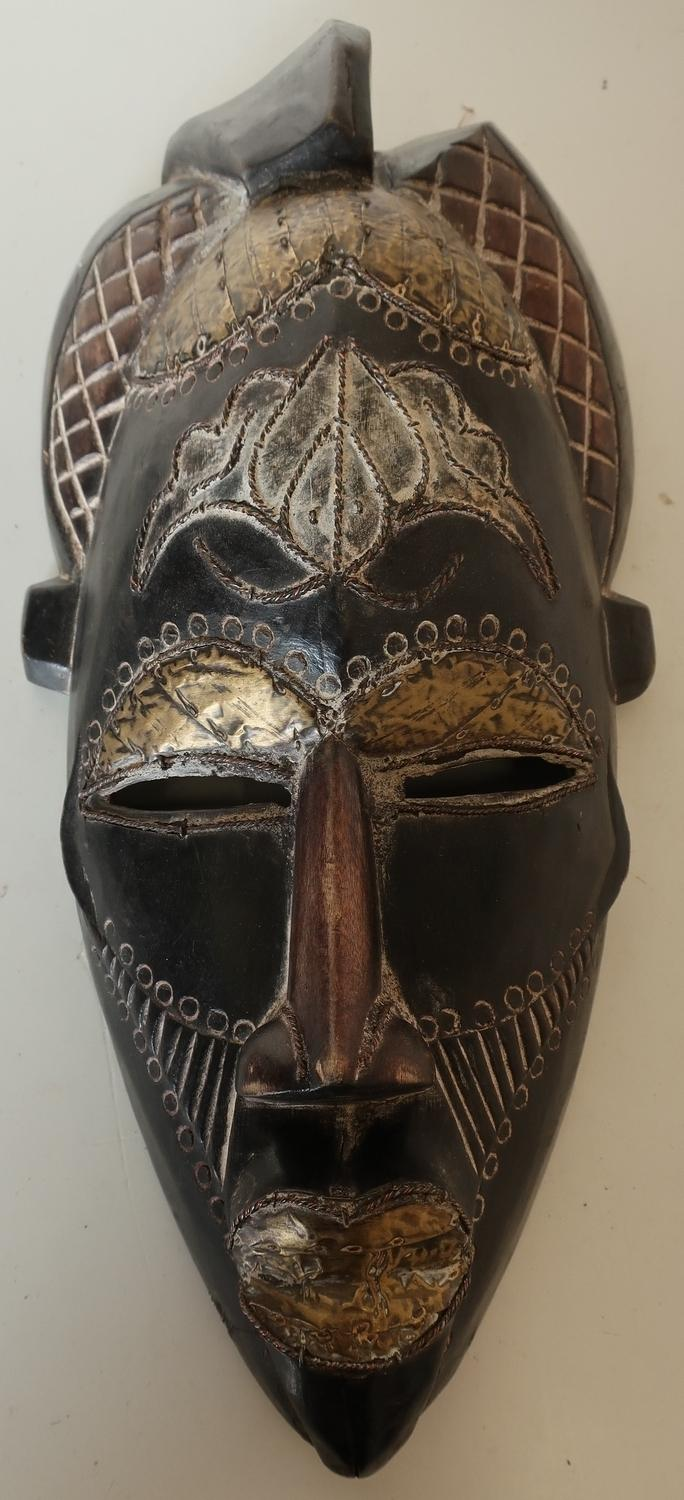 Lot 163 - Carved wood African tribal face mask with brass metal mounts