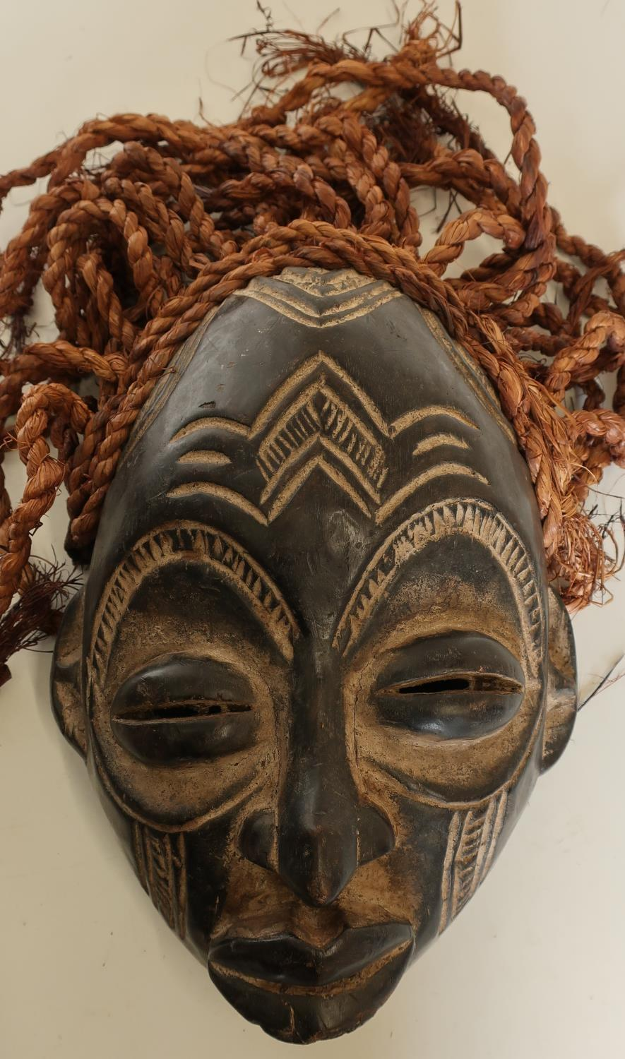 Lot 145 - Carved African tribal style mask with hessian ropework hair