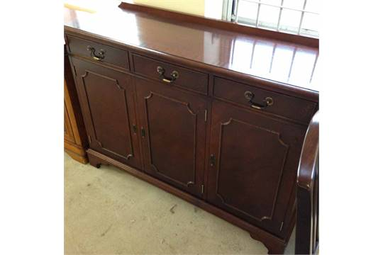 A Multiyork mahogany sideboard - 3 doors with drawers above.