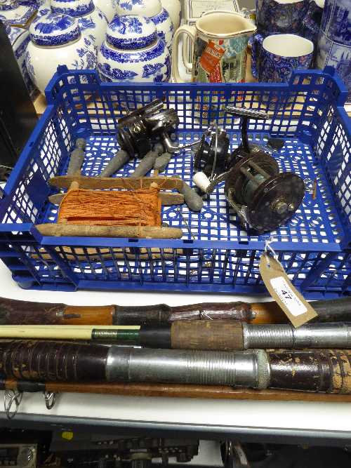 Lot 47 - A basket of fishing equipment : reels, lead weights,
