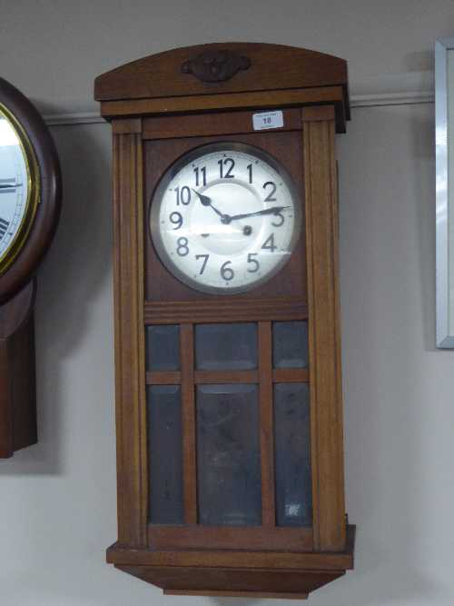 Lot 18 - An oak cased wall clock, two framed pictures, continental figure,