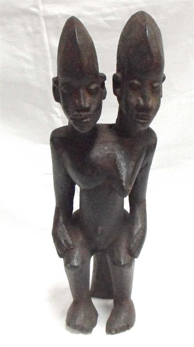 Lot 189 - An African hardwood carving, depicting a two headed male/female figure 48cm high