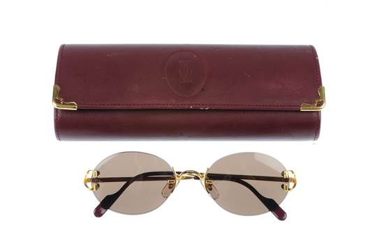 6b588d7513 CARTIER - a pair of rimless sunglasses. Featuring oval shaped brown ...