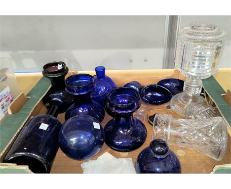 An Art Deco cut glass table lamp; a similar carafe; a selection of blue glass pieces