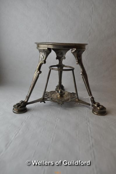 Lot 7317 - A Tiffany silver kettle stand, the circular top on tripod supports ending in large paw feet, stamped