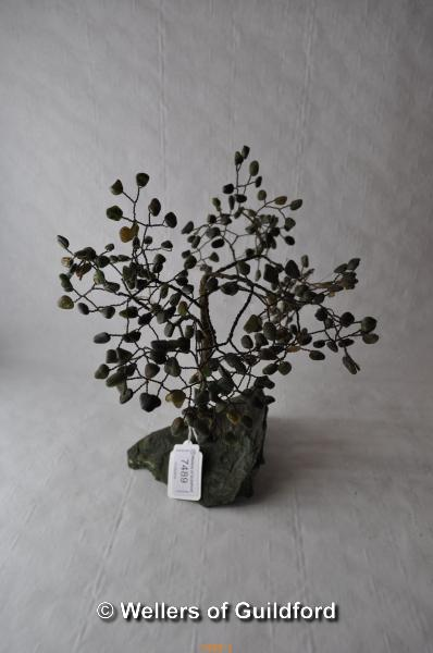 Lot 7489 - An ornamental tree with green hardstone leaves and malachite base, 25cms tall.