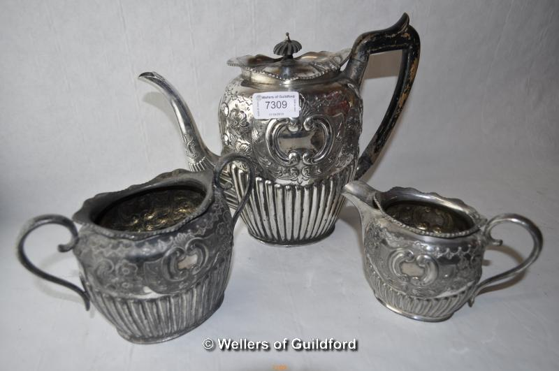 Lot 7309 - *William Page & Co silver plate repousse tea set comprising teapot, milk and sugar (Lot subject to