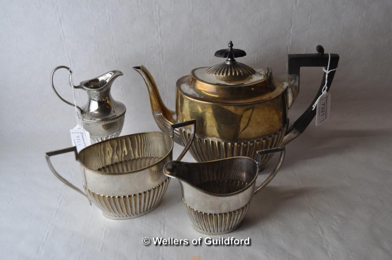Lot 7321 - A three piece silver plated tea set and a similar cream jug.
