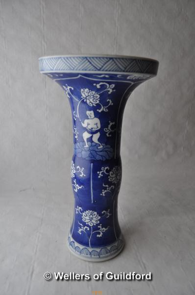 Lot 7545 - A Chinese blue and white vase with flared rim, blue rings to base 23cm.