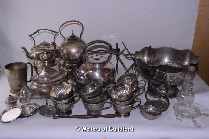 Lot 7324 - A quantity of silver plated wares including spirit kettles with stands, a punchbowl with cups, a