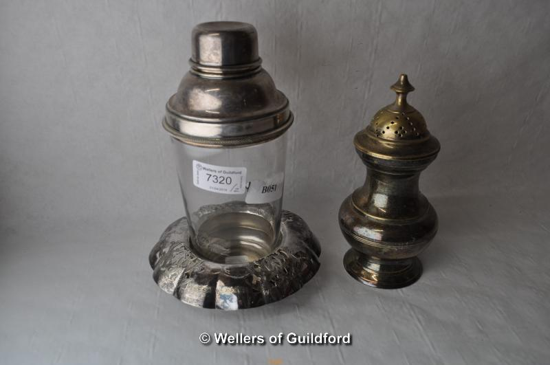 Lot 7320 - A glass cocktail shaker with silver plated lid and separate stand; a silver plated sugar caster (2)