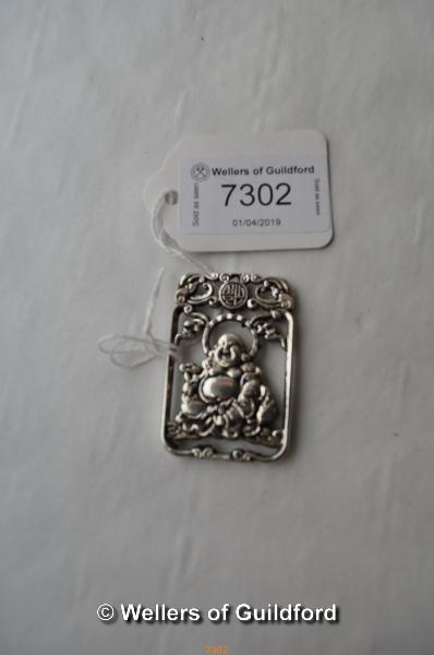 Lot 7302 - A Chinese white metal pendant with smiling Buddha.