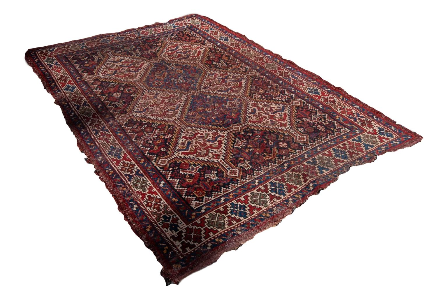 Lot 27 - SHIRAZ PERSIAN RUG, with three rows of diamond shaped pole medallions, the centre row with