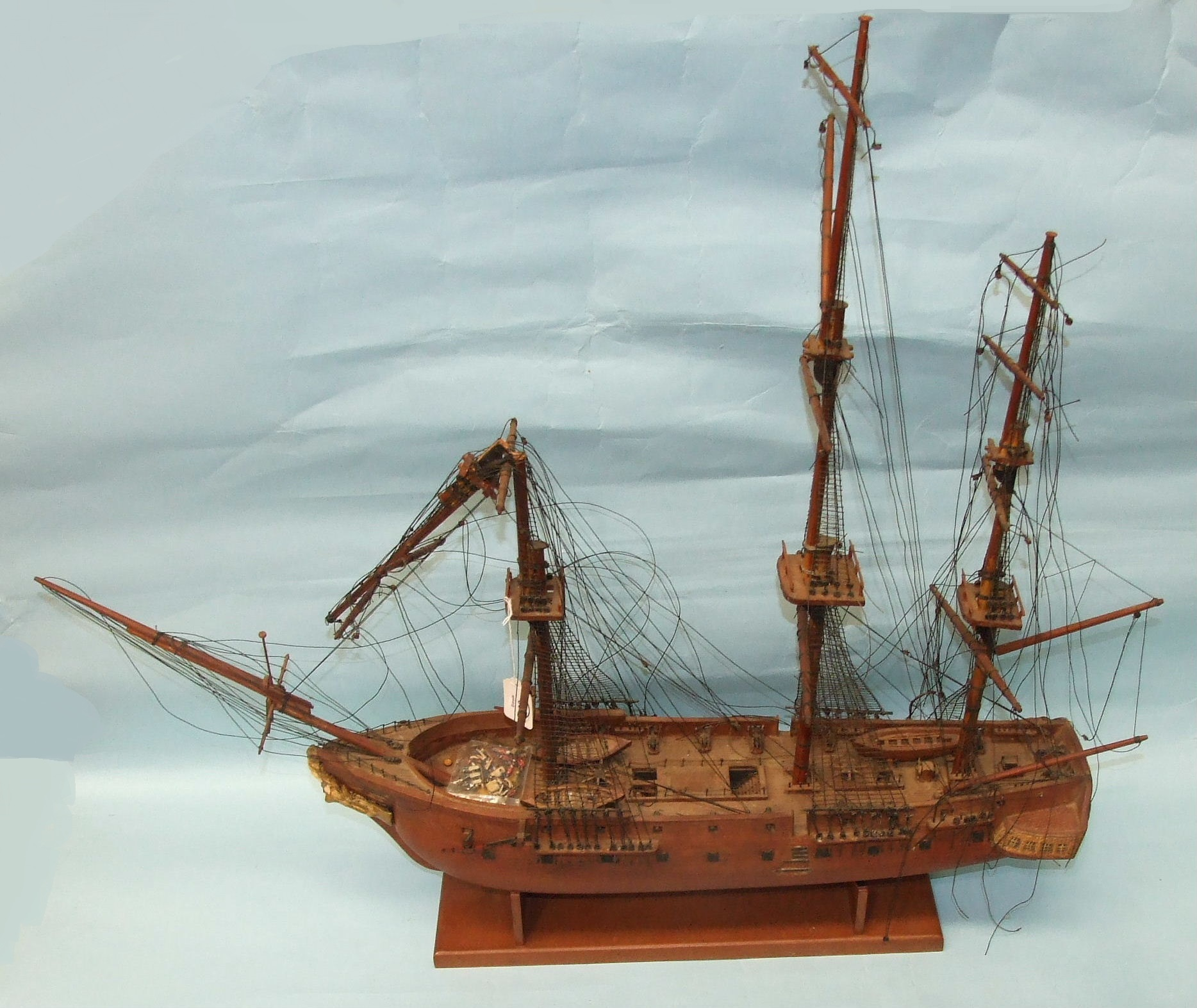 """Lot 38 - A 20th century scratch built hardwood model of a three-masted brig, """"Medallion"""", with solid hull,"""