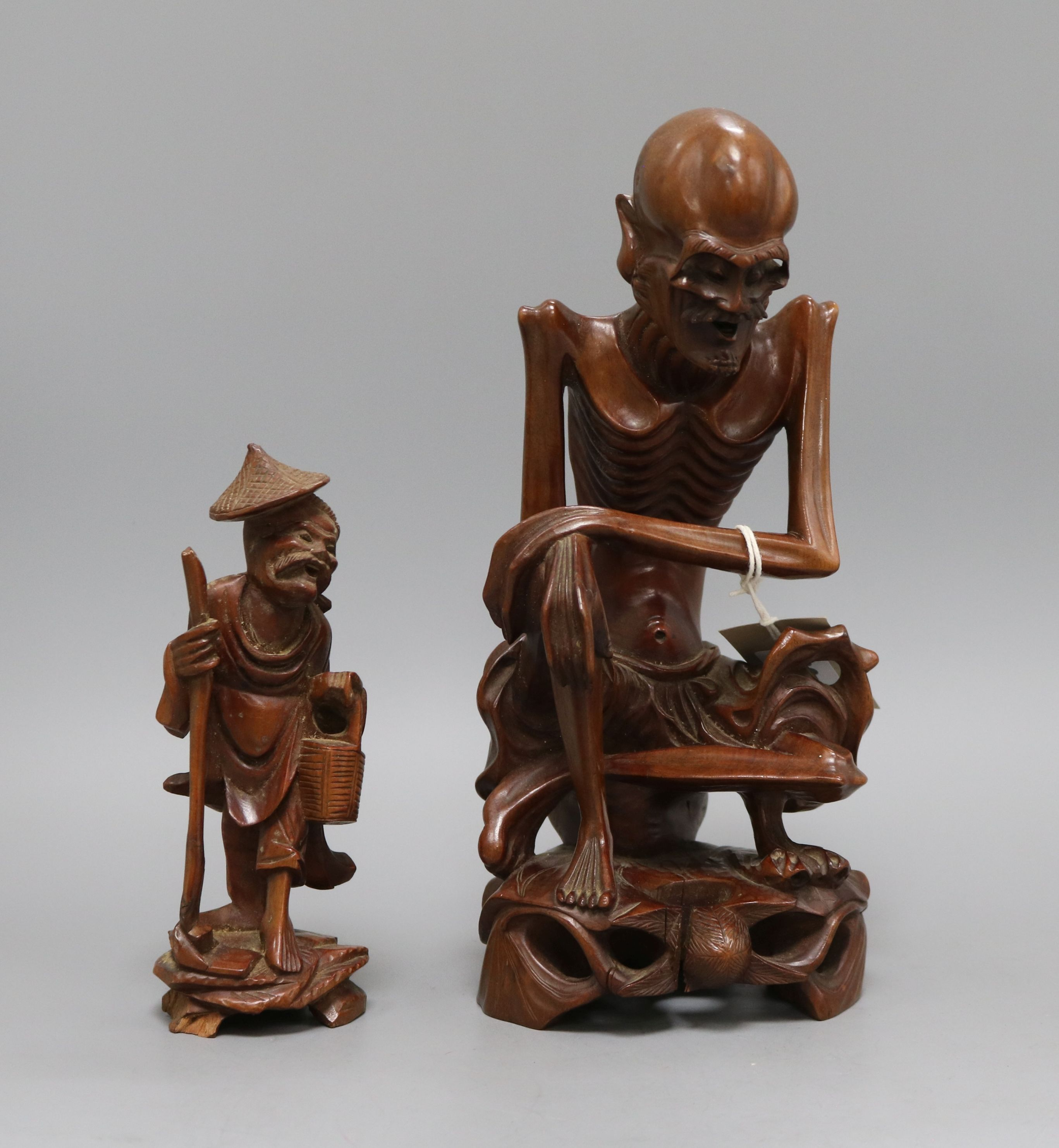 Lot 30 - Two Chinese wooden figural carvings tallest 28cm