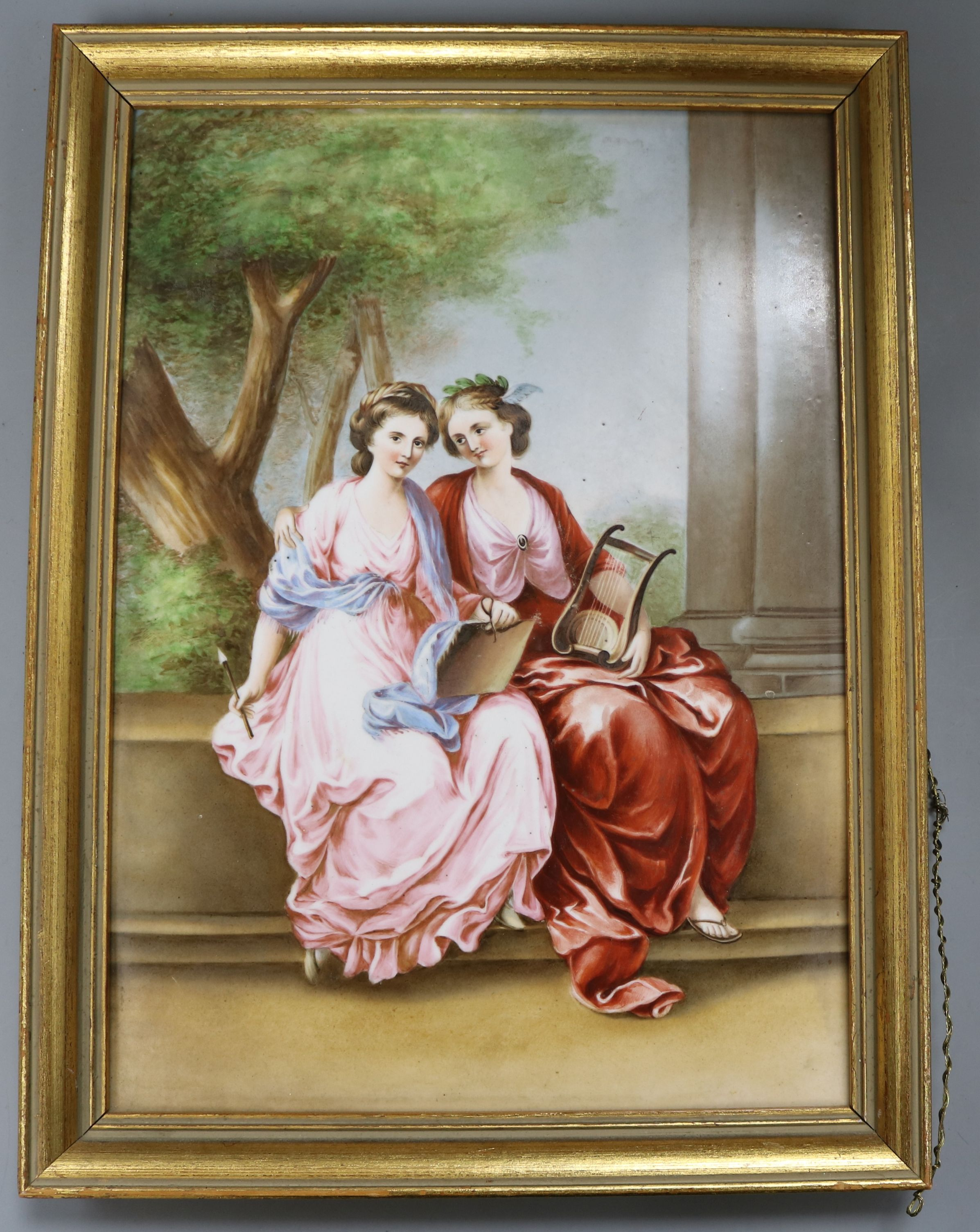 Lot 52 - A painted porcelain plaque depicting seated females height 34cm incl. frame