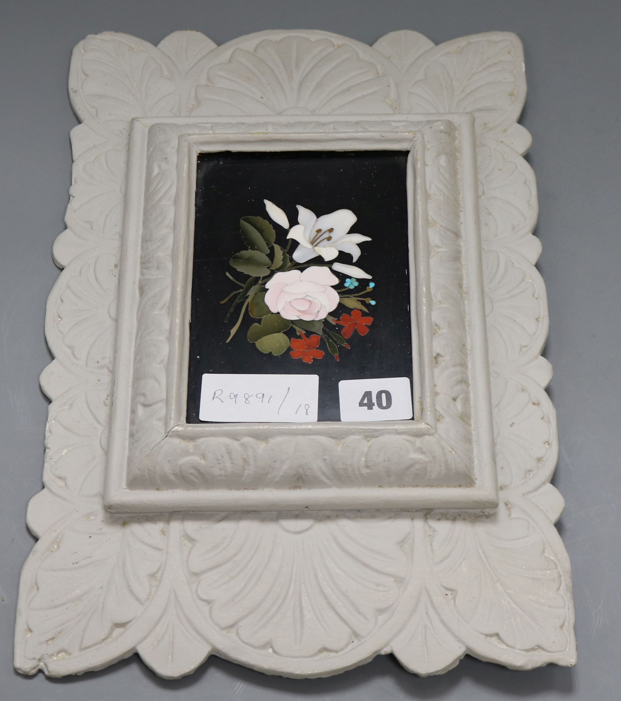 Lot 40 - A pietra dura plaque in carved frame height 36cm