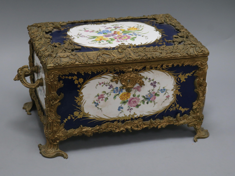 Lot 31 - A porcelain and brass mounted casket length 39cm